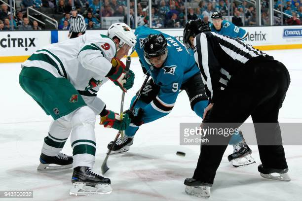 Mikko Koivu of the Minnesota Wild and Evander Kane of the San Jose Sharks faceoff at SAP Center on April 7 2018 in San Jose California