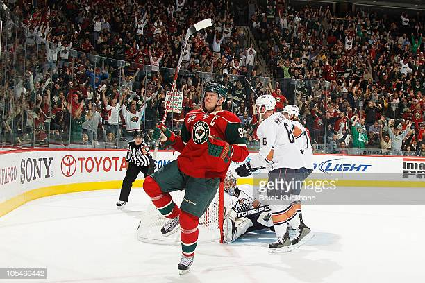 Mikko Koivu of the Minnesota Wild celebrates after scoring a goal against the Edmonton Oilers during the game at the Xcel Energy Center on October 14...