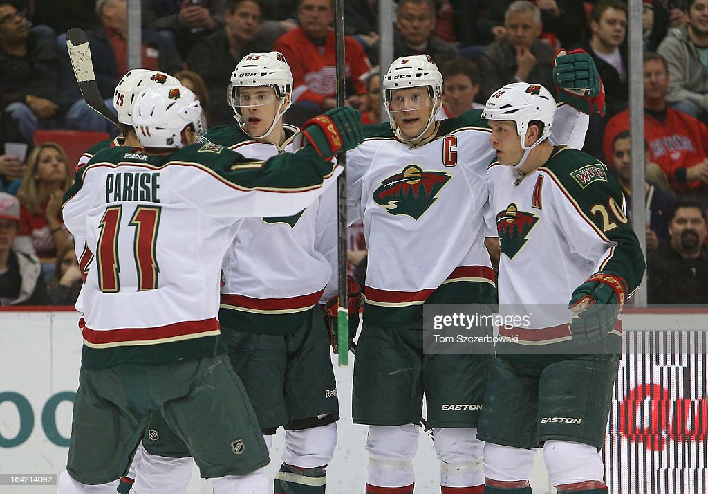 Mikko Koivu #9 of the Minnesota Wild celebrates his goal with Jonas Brodin #25, Zach Parise #11,Charlie Coyle #63 and Ryan Suter #20 in NHL action against the Detroit Red Wings at Joe Louis Arena on March 20, 2013 in Detroit, Michigan.
