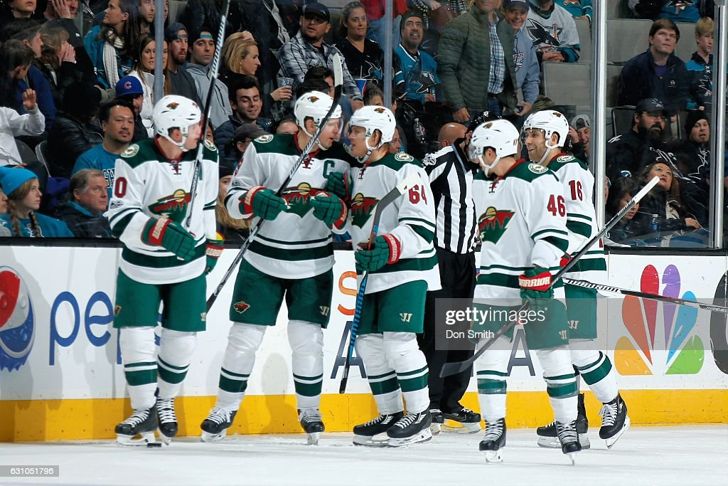Mikko Koivu #9 of the Minnesota Wild celebrates his third period goal with teammates during a NHL game against the San Jose Sharks at SAP Center at San Jose on January 5, 2017 in San Jose, California.