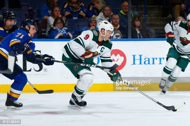 Mikko Koivu of the Minnesota Wild controls the puck against Vladimir Sobotka of the St Louis Blues at Scottrade Center on February 6 2018 in St Louis...