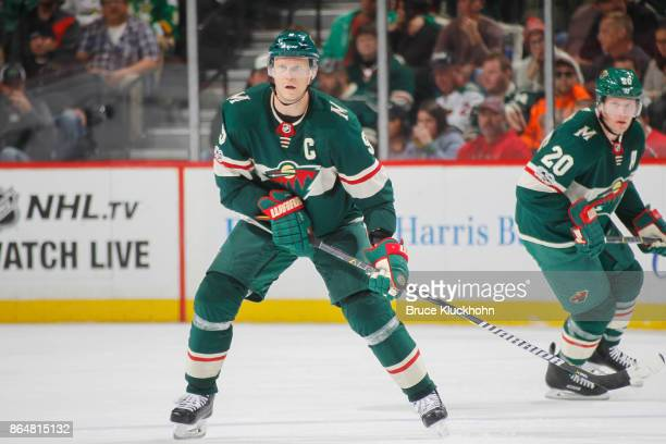 Mikko Koivu of the Minnesota Wild defends against the Columbus Blue Jackets during the game at the Xcel Energy Center on October 14 2017 in St Paul...