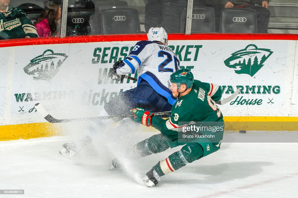 Mikko Koivu #9 of the Minnesota Wild defends Blake Wheeler #26 of the Winnipeg Jets during the game at the Xcel Energy Center on January 13, 2018 in St. Paul, Minnesota.