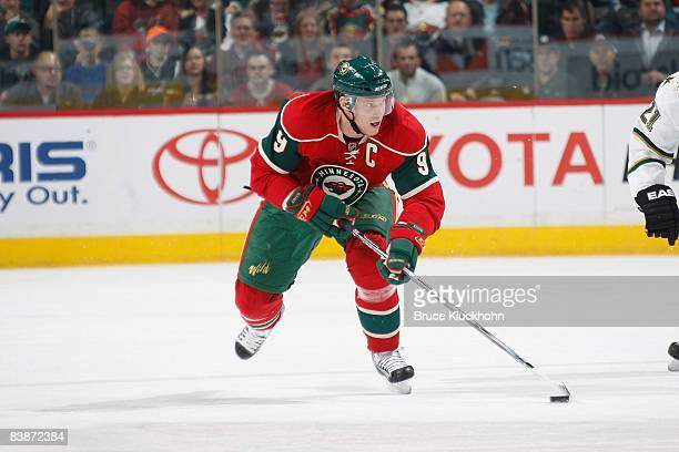 Mikko Koivu of the Minnesota Wild handles the puck against the Dallas Stars during the game at the Xcel Energy Center on November 26 2008 in Saint...