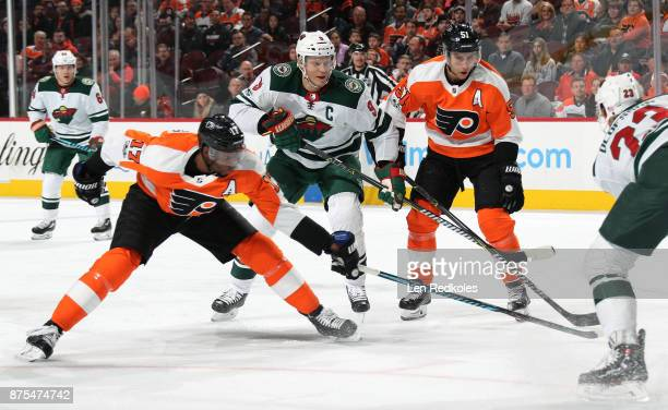 Mikko Koivu of the Minnesota Wild in action against Wayne Simmonds and Valtteri Filppula of the Philadelphia Flyers on November 11 2017 at the Wells...