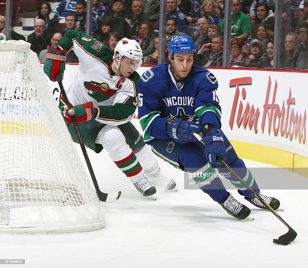 Mikko Koivu #9 of the Minnesota Wild pursues Aaron Volpatti #15 of the Vancouver Canucks during their NHL game at Rogers Arena February 12, 2013 in Vancouver, British Columbia, Canada. Vancouver won 2-1
