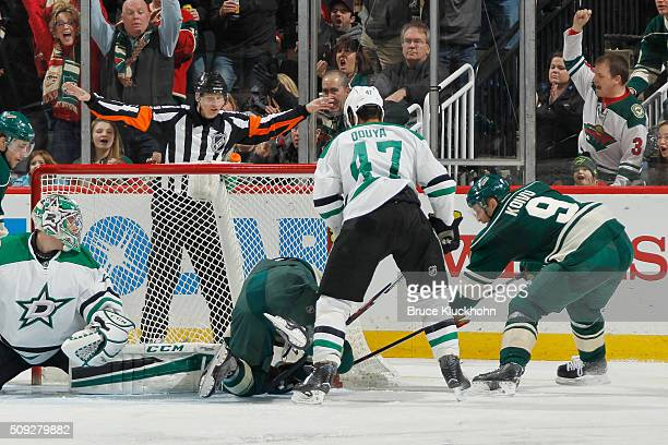 Mikko Koivu of the Minnesota Wild scores a goal upon official review after it is initially waved off against Johnny Oduya and goalie Kari Lehtonen of...