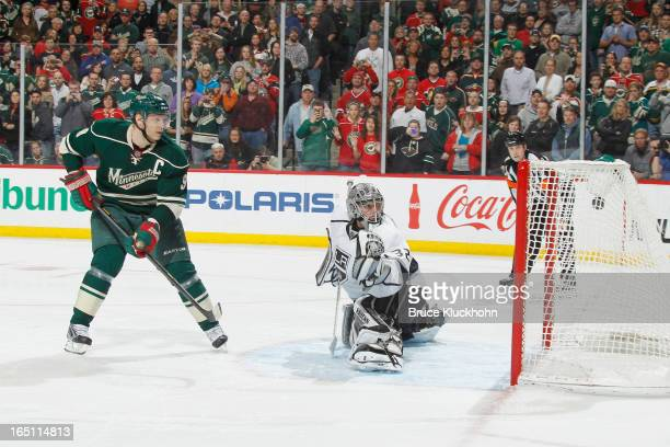 Mikko Koivu of the Minnesota Wild scores a shootout goal against Jonathan Quick of the Los Angeles Kings during the game on March 30 2013 at the Xcel...