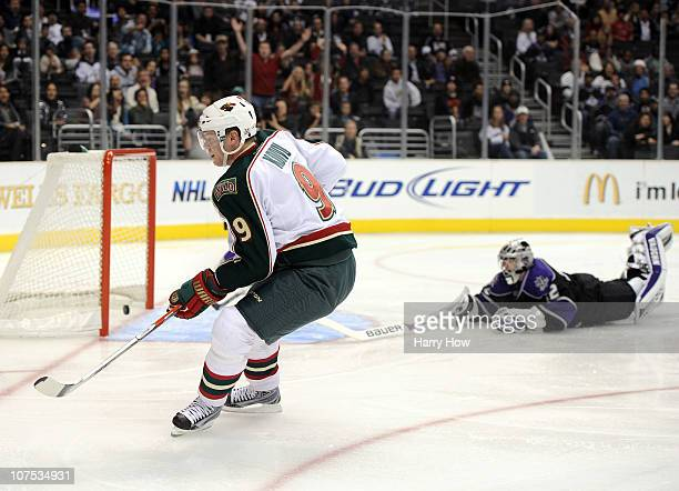 Mikko Koivu of the Minnesota Wild scores a short handed goal in past a diving Jonathan Quick of the Los Angeles Kings for a 10 lead during the first...