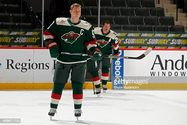 Mikko Koivu of the Minnesota Wild skates out with the other captains to a press conference to unveil the uniform for the 2016 Coors Light Stadium...