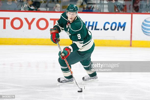 Mikko Koivu of the Minnesota Wild skates with the puck against the Dallas Stars during the game at Energy Center on November 07 2009 in Saint Paul...