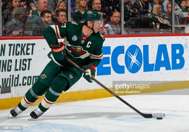 Mikko Koivu of the Minnesota Wild skates with the puck during a game between the Minnesota Wild and Washington Capitals at Xcel Energy Center on...