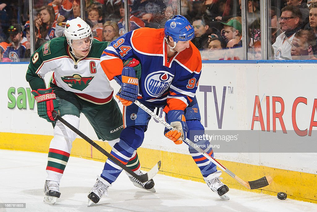 Mikko Koivu #9 of the Minnesota Wild tries to tie up Ryan Smyth #94 of the Edmonton Oilers during an NHL game at Rexall Place on April 16, 2013 in Edmonton, Alberta, Canada.