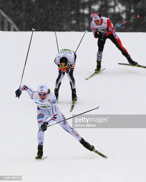 Mikko Kokslien from Norway Mario Seidl from Austria and Takehiro Watanabe from Japan in action during the men's team combination normal hill/4x5 km...