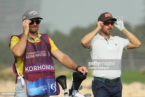 Mikko Korhonen of Finland and his caddie look on whilst on the 18th hole during the fourth round of the Commercial Bank Qatar Masters at the Doha...