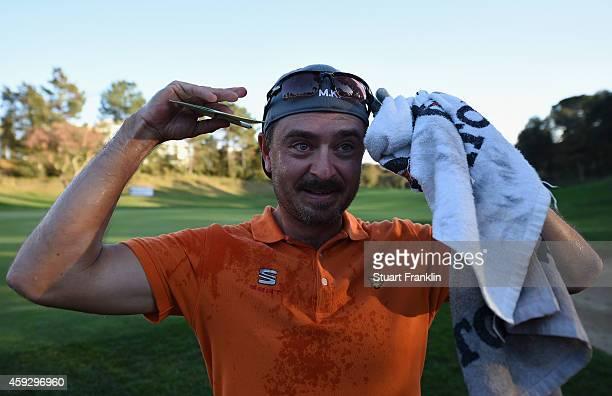 Mikko Korhonen of Finland celebrates winning during the final round of the European Tour qualifying school final stage at PGA Catalunya Resort on...