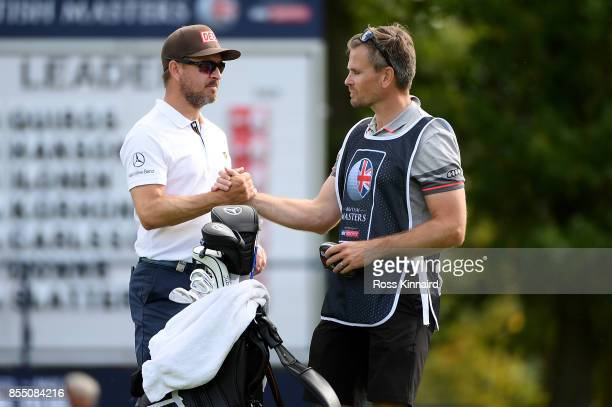 Mikko Korhonen of Finland celebrates with his caddy on the 9th hole during day one of the British Masters at Close House Golf Club on September 28...