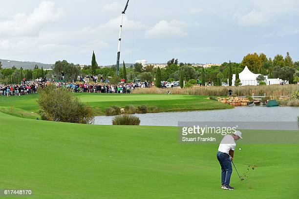 Mikko Korhonen of Finland hits an approach during day four of the Portugal Masters at Victoria Clube de Golfe on October 23 2016 in Vilamoura Portugal