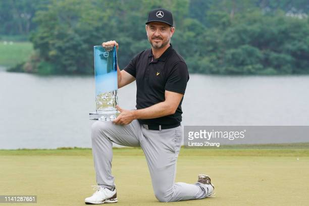 Mikko Korhonen of Finland holds the trophy celebrates after winning the 2019 Volvo China Open at Genzon Golf Club on May 5 2019 in Shenzhen China