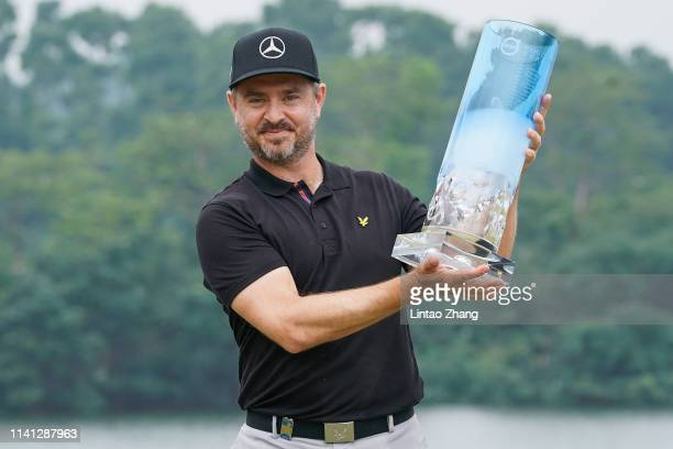 Mikko Korhonen of Finland holds the trophy celebrates after winning the 2019 Volvo China Open at Genzon Golf Club on May 5, 2019 in Shenzhen, China.