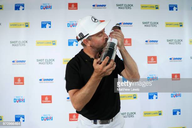 Mikko Korhonen of Finland kisses the trophy after winning The 2018 Shot Clock Masters during day four of The 2018 Shot Clock Masters at Diamond...