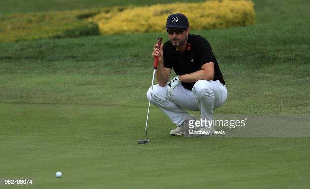 Mikko Korhonen of Finland lines up a putt on the 18th hole during the fourth round of the BMW International Open at Golf Club Gut Larchenhof on June...