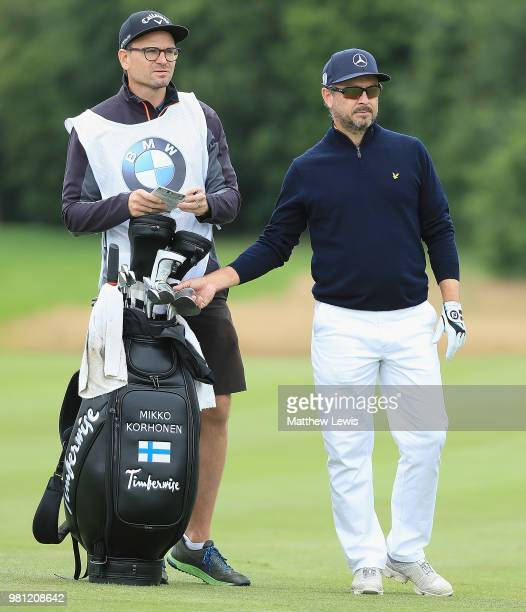Mikko Korhonen of Finland looks on with his caddie during day two of the BMW International Open at Golf Club Gut Larchenhof on June 22 2018 in...
