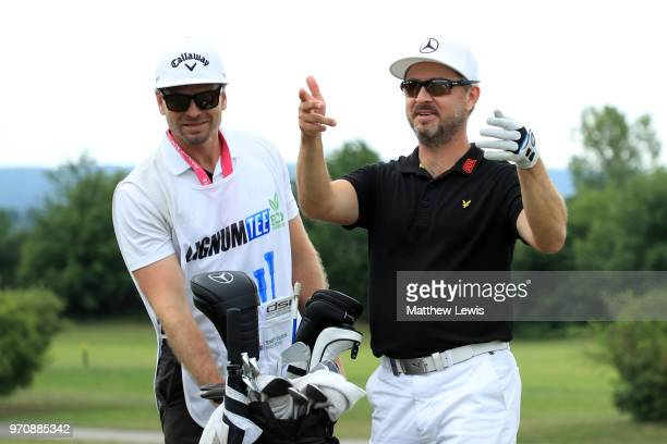 Mikko Korhonen of Finland looks on with his caddy after suspension of play due to weather during day four of The 2018 Shot Clock Masters at Diamond...