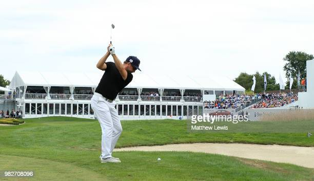 Mikko Korhonen of Finland plays his second shot on the 18th hole during the fourth round of the BMW International Open at Golf Club Gut Larchenhof on...