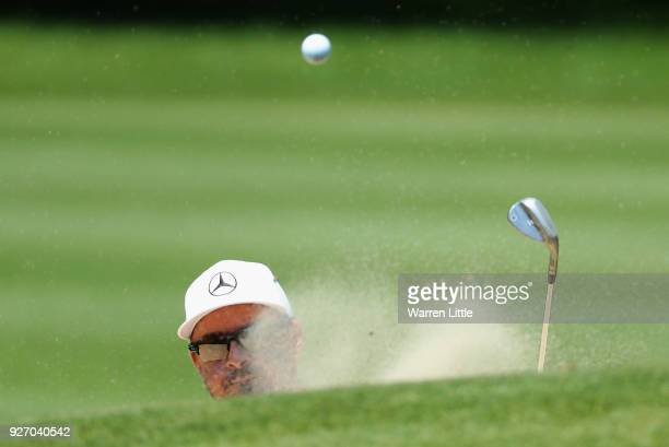 Mikko Korhonen of Finland plays out of the first greenside bunker during the final round of the Tshwane Open at Pretoria Country Club on March 4,...
