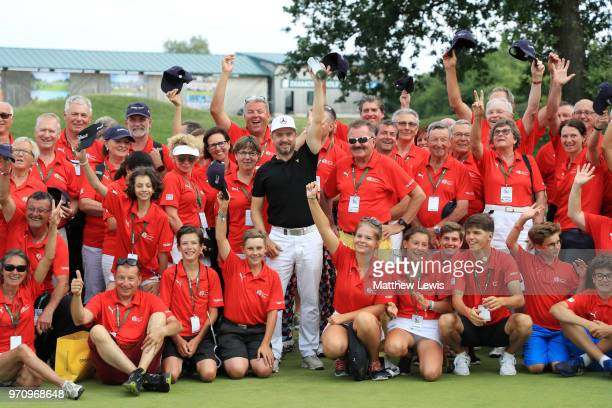 Mikko Korhonen of Finland pose for a photo with volunteers after he won The 2018 Shot Clock Masters during day four of The 2018 Shot Clock Masters at...