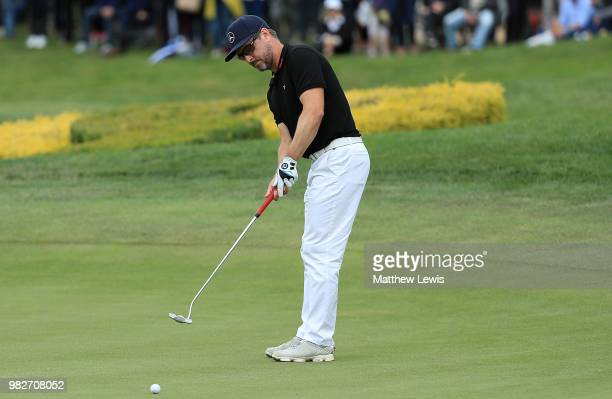Mikko Korhonen of Finland putts on the 18th hole during the fourth round of the BMW International Open at Golf Club Gut Larchenhof on June 24 2018 in...