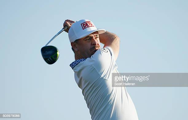 Mikko Korhonen of Finland watches his tee shot on the third hole during the first round of the Abu Dhabi HSBC Golf Championship at the Abu Dhabi Golf...