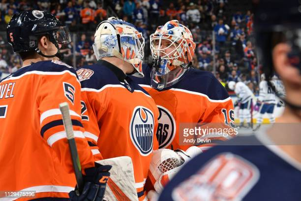 Mikko Koskinen and Anthony Stolarz of the Edmonton Oilers warm up prior to the game against the Toronto Maple Leafs on March 9 2019 at Rogers Place...