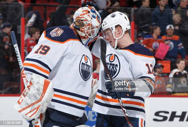 Mikko Koskinen and Colby Cave of the Edmonton Oilers celebrate their win over the Ottawa Senators at Canadian Tire Centre on February 28, 2019 in...