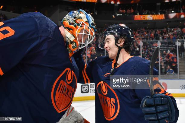 Mikko Koskinen and Kailer Yamamoto of the Edmonton Oilers celebrate after winning the game against the St. Louis Blues on January 31 at Rogers Place...