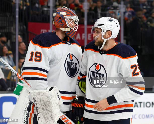 Mikko Koskinen and Leon Draisaitl of the Edmonton Oilers talk during a stop in play in the second period of a game against the Vegas Golden Knights...