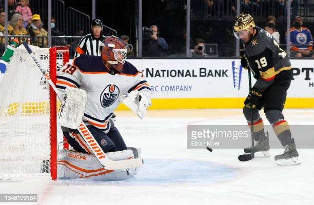 Mikko Koskinen of the Edmonton Oilers blocks a shot by Jonathan Marchessault of the Vegas Golden Knights as Reilly Smith of the Golden Knights looks...