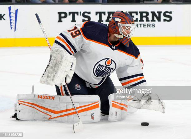 Mikko Koskinen of the Edmonton Oilers covers the puck in the second period of a game against the Vegas Golden Knights at T-Mobile Arena on October...