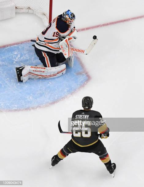 Mikko Koskinen of the Edmonton Oilers makes a save as Paul Stastny of the Vegas Golden Knights looks for a rebound in the third period of their game...