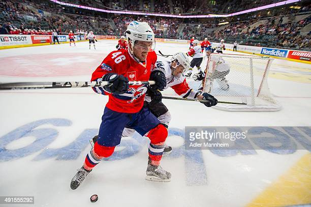 Mikko Kukkonen of Espoo Blues in action with Jonathan Rheault of Adler Mannheim during the Champions Hockey League round of thirty-two game between...