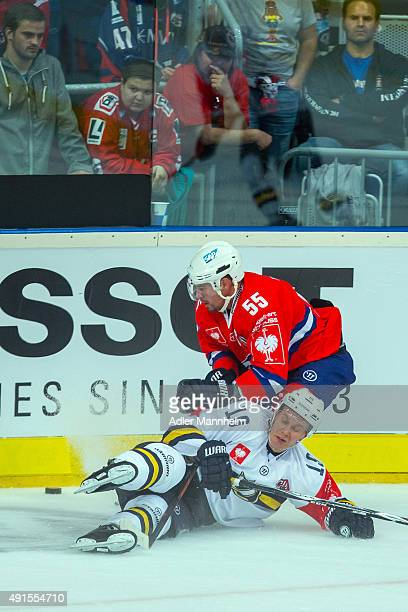 Mikko Kuukka of Espoo Blues in action with Jochen Hecht of Adler Mannheim during the Champions Hockey League round of thirty-two game between Adler...