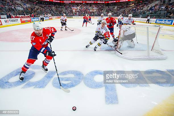 Mikko Kuukka of Espoo Blues in action with Ryan MacMurchy of Adler Mannheim during the Champions Hockey League round of thirty-two game between Adler...