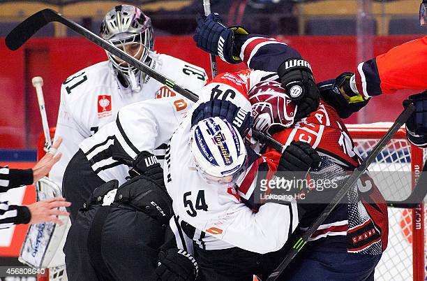 Mikko Lehtonen and Broc Little fights during the Champions Hockey League group stage game between Linkoping HC and TPS Turku on October 7 2014 in...