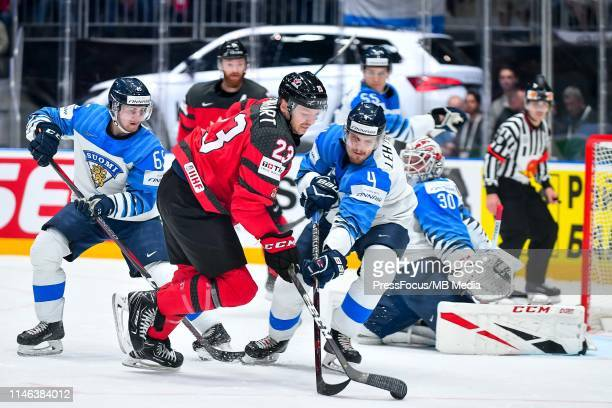 Mikko Lehtonen of Finland tackles Sam Reinhart of Canada during the 2019 IIHF Ice Hockey World Championship Slovakia final game between Canada and...