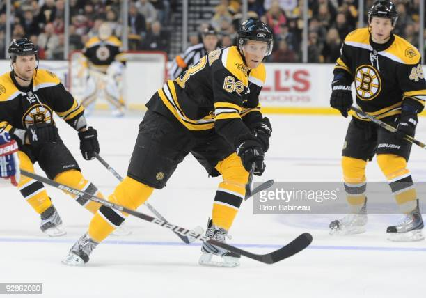 Mikko Lehtonen of the Boston Bruins backhands the puck into the offensive zone during the game against the Montreal Canadiens at the TD Garden on...
