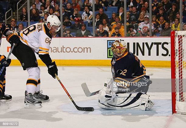 Mikko Lehtonen of the Boston Bruins is stopped by Mikael Tellqvist of the Buffalo Sabres on April 11 2009 at HSBC Arena in Buffalo New York