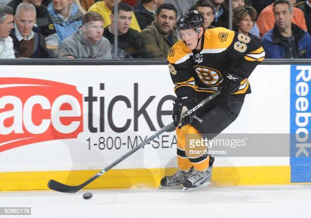 Mikko Lehtonen of the Boston Bruins skates with the puck during the game against the Montreal Canadiens at the TD Garden on November 5, 2009 in...