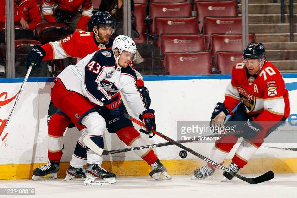 Mikko Lehtonen of the Columbus Blue Jackets crosses sticks with Patric Hornqvist of the Florida Panthers at the BB&T Center on April 19, 2021 in...