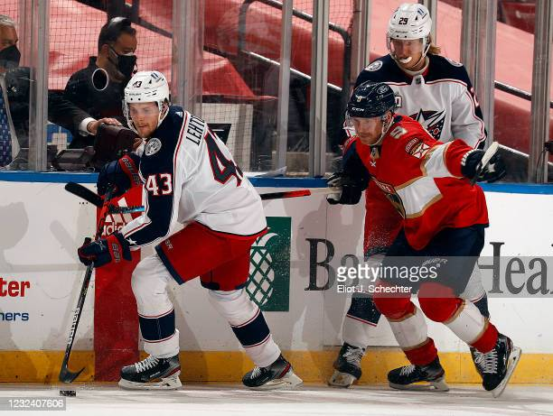Mikko Lehtonen of the Columbus Blue Jackets skates for possession against Sam Bennett of the Florida Panthers at the BB&T Center on April 19, 2021 in...